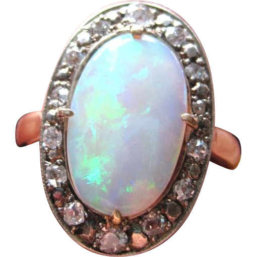 Vintage Hallmarked 18k yellow gold ring set with diamonds and an oval opal ring size 6 1/2