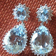 Exceptional pair of 18kwg earrings over 7.50 carats of aquamarines and 84 diamonds weighing 1.68 carats with appraisal