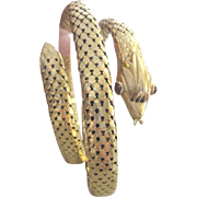 Appraised 18k yellow gold mesh coiled snake bracelet with ruby eyes