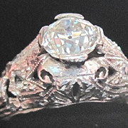 Platinum and seven diamond filagree engagement ring