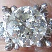 Vintage Platinum European cut 1.00 carat center diamond plus two brilliant cut tw.0.14 engagement ring