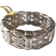 Ladies 14k white gold diamond studded eternity band in size 8