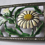 Silver tone metal enameled flower pin surrounded by marcascites