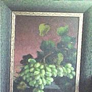 Framed still life painting of lush grapes