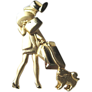 Vintage costume jewelry pin figural or a mega shopper and her dog