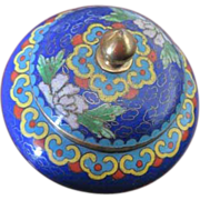 Chinese Cloisonne covered jar with multiple flowers