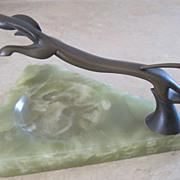Austrian Art Deco bronze running dog ashtray on marble