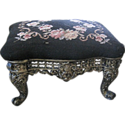 Vintage ornate cast iron foot stool with needlepoint top