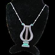 14k YG Emerald and Enamel lyre pendant on 14kWG Diamond chain