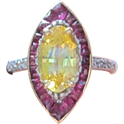 Ladies ring 18k set with navette yellow sapphire rubies & diamonds