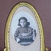 Victorian brass oval picture frame with dolphin decoration