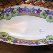 Handpainted Bavarian Celery dish decorated with violets gold trim