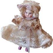19thC miniature early all bisque toddler in Original outfit