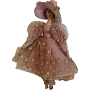 1830s Grodnertal wooden doll with side curls and early costume