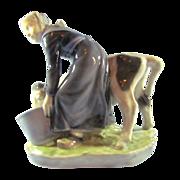 Royal Copenhagen Figurine Girl With Calf No. 779