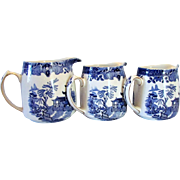 Three Staffordshire Burleigh Ware Graduated Blue Willow Pitchers