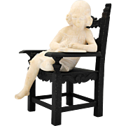 Carved Alabaster Figure of a Girl Reading a Book in a Bronze Chair