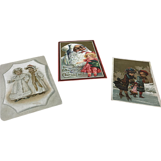 Three Antique Christmas/ Doll Themed post & advertising cards Bisque doll display