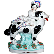 Early Victorian Staffordshire of a Royal Child Riding on His St. Bernard Dog