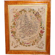 A Fine Early Victorian Silkwork Map of England and Wales Set within a Border of Embroidered Flowers and Foliage