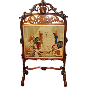 Early Victorian Pettipoint Panel Depicting a Group of Dogs Set in Hand-Carved Rosewood Firescreen