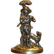 A 19th Century Finely Detailed Cast Brass Doorstop Modeled as a Woodsman with Dog