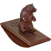 Late 19th Century Swiss Carved Pine Rocking Ink Blotter with Seated Bear