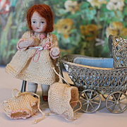 Adorable all bisque antique doll, girl with snowball, tiny dress & bonnet, red hair, painted eyes and face, antique German filigree metal carriage.