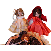 Set of 3 small dolls, 2 are hard plastic Nancy Ann Story Book dolls, Purple one is unknown maker. Vintage dolls. You get all 3! Great condition!