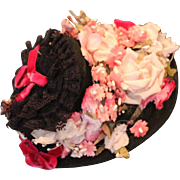 "Gorgeous Black Vintage floral doll hat with  vintage flowers in pinks! Dark pink  velvet ribbons. Fits on a 10"" head circumference."