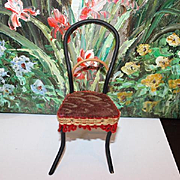 """Bentwood doll chair, original fabric on seat and wool trim.  5 1/2"""" tall in size 2 3/4"""" wide on the legs. Doll house furniture!"""