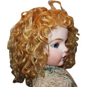 """13"""" head circumference on this synthetic mohair wig.  Strawberry blond in color. Looks and feels like mohair! Great condition!"""