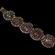 "Vintage Judy Lee metal bracelet, 7 1/2"" long around the wrist. 1 3/8"" wide, multi color enamel like design, Gold tone color, no stones."