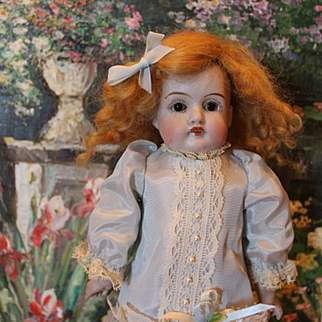 "11"" petite Antique German Kestner doll! No hairlines, Great kid leather body, bisque hands, mohair wig, sleep eyes, rayon dress, marked head under wig."