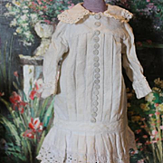 """Great old thick cotton doll dress, Lots of decorative buttons up the front of the dress. Fits a 14-15"""" tall doll! White color, with some age stains. Vintage or Antique doll dress."""