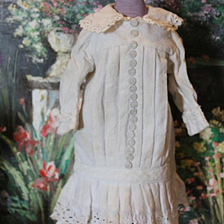"""Great old 1980's  thick cotton doll dress, Lots of decorative buttons up the front of the dress. Fits a 14-15"""" tall doll! White color, with some age stains. Vintage or Antique doll dress."""