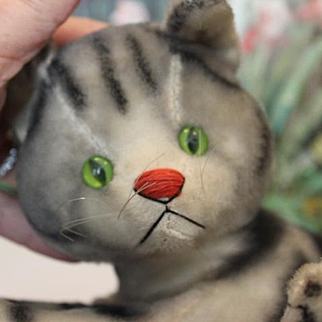"""Mohair untagged Steiff gray grey tabby Cat, laying down, green glass eyes, 9"""" long in size. no button."""