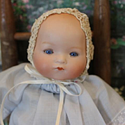 "Sweet 9 1/2"" -10"" long German Antique Armand Marseille, AM Baby Dream Baby, bisque head, original cloth body, cryer mechanism does not work, plastic hands."