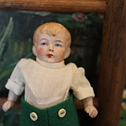 "Sweet German Antique all Bisque Boy Doll, 4 1/2"" tall dollhouse doll, Incised ""Germany 2"" on the back. 2 tiny chips on one upper thigh leg area. Sweet!"