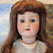 "22 1/2"" tall Heubach Koppelsdorf German Bisque head, Antique Doll, mold number 2503, replaced antique hands and lower arm is replaced with antique parts."