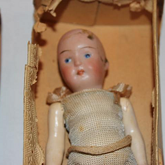German Antique bisque head, compo body, Strobel & Wilken doll, In original box, no wig no hairlines. Made in Germany!