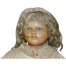 English Antique Wax shoulderhead doll with facial damage, kid leather arms cloth body, mohair wig. 25' long in size.