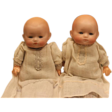 "Tiny AM, Armand Marseille Twin babys, Baby Phyllis, boy and girl set, in their baby gowns with pink and blue trim, 8"" long in size! Bisque head, compo hands and sleep eyes."