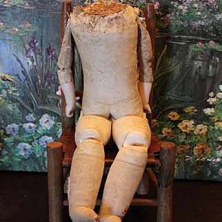"""German Antique kid leather doll body with cloth lower feet. 14 1/4"""" long in size. no shoulderhead, body only. Some repairs, patches on the body."""