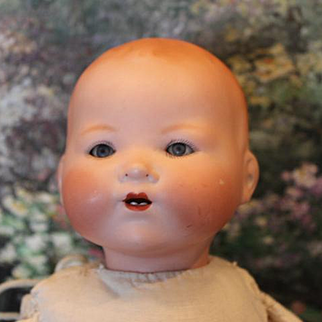 """14 1/2"""" long, Armand Marseille, #351 Antique German baby, with blue sleep eyes, new body, bisque head, new hands."""