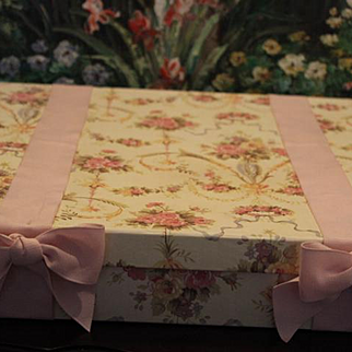 """1980's Trousseau cardboard floral display box with floral pattern and pink  ribbon bows!  Approximately 14"""" X 14"""" X 3"""" in size."""