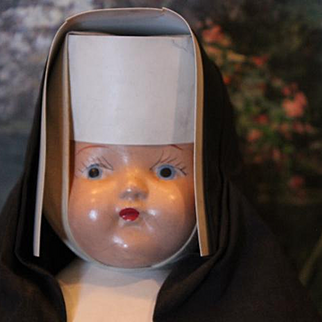 """Vintage Nun Doll in original costume, replaced legs with crazing on them. 13"""" tall, composition doll"""