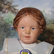 Carved Hair Wood Schoenhut Girl Doll,  braided on the sides with a red bow in back