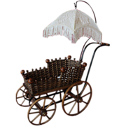 Vintage doll baby  buggy, carriage, wood, wagon wheels, woven, metal trim. Parasol umbrella top with fringe.