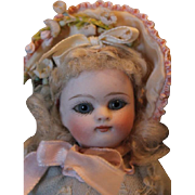 """French All Bisque Cutie with Amazing face! 6"""" tall in size, original mohair wig, painted and molded pink socks and black 2 strap shoes, blue glass eyes, replaced arms. Beautiful Doll!"""